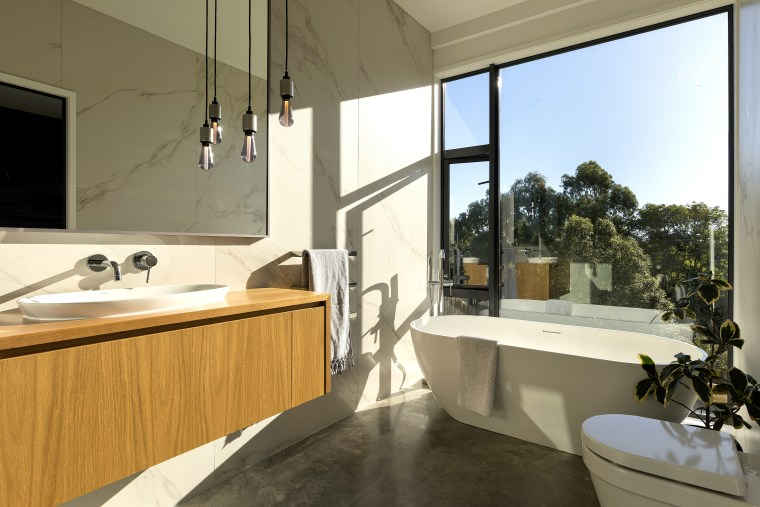 Both the main bedroom and ensuite feel completely architecture, bathroom, bathroom cabinet, bathtub, building, floor, furniture, home, house, interior design, material property, plumbing fixture, property, real estate, room, sink, tap, brown