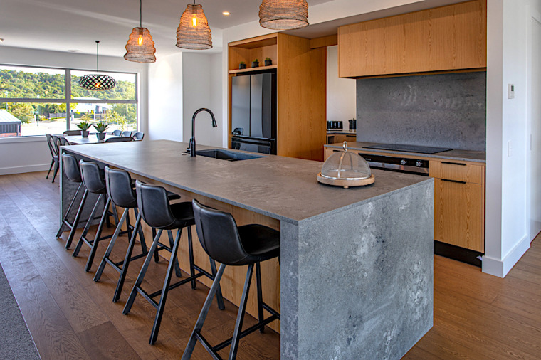 The look of wood meets the look of architecture, bar stool, building, cabinetry, countertop, design, dining room, floor, flooring, furniture, granite, hardwood, home, house, interior design, kitchen, property, real estate, room, stool, table, wood, wood flooring, wood stain, gray, brown