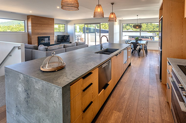 Warm, rich timber flooring and cabinetry provides vivid architecture, building, cabinetry, ceiling, countertop, floor, flooring, furniture, granite, hardwood, home, house, interior design, kitchen, plywood, property, real estate, room, tile, wood, wood flooring, wood stain, gray
