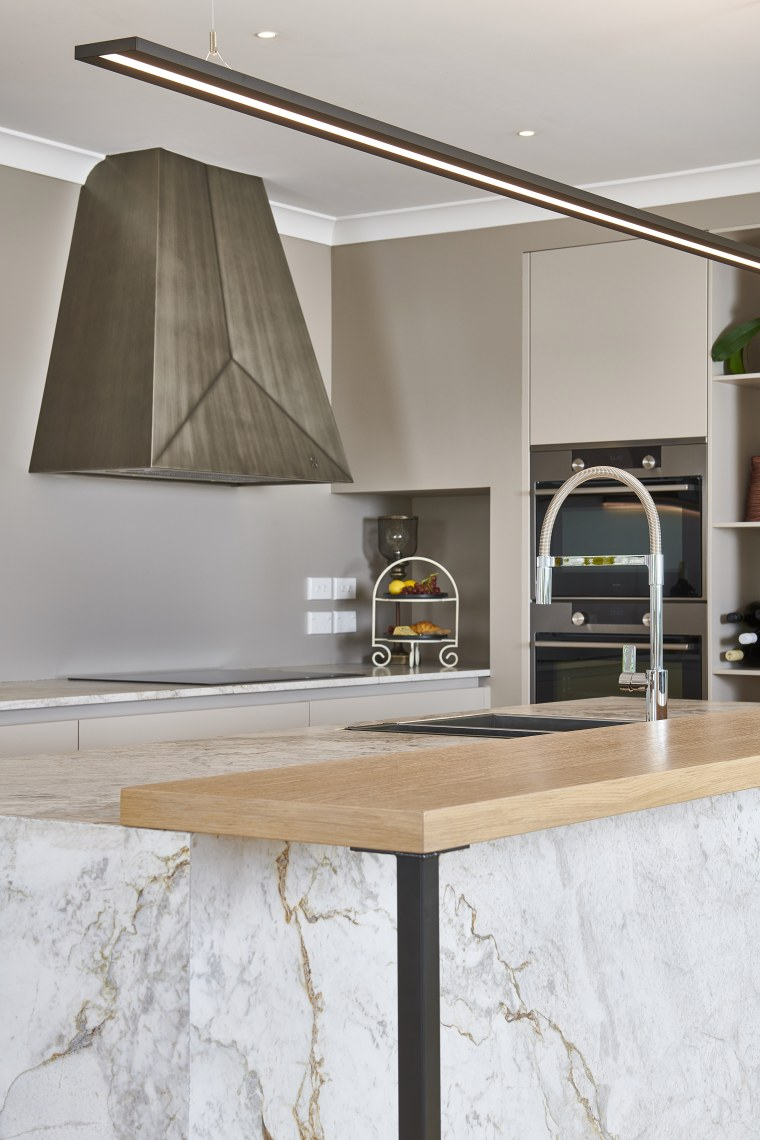 The semi-industrial patinated metal rangehood is a feature cabinetry, ceiling, countertop, floor, flooring, furniture, house, interior design, kitchen, material property, property, room, shelf, table, tile, gray