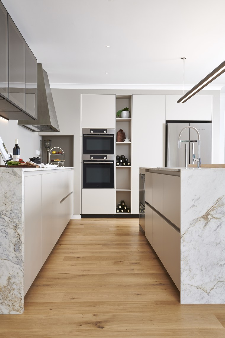 Classic tones meet modern, minimalist touches like recessed architecture, beige, building, cabinetry, ceiling, countertop, floor, flooring, furniture, hardwood, home, house, interior design, kitchen, laminate flooring, living room, loft, material property, property, room, tile, white, wood flooring, white