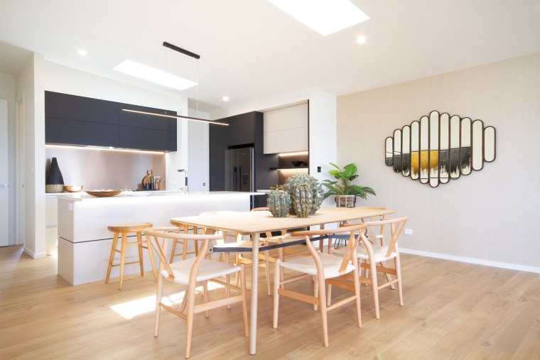 Let me entertain you – the dining area apartment, building, ceiling, dining room, floor, flooring, furniture, hardwood, home, house, interior design, laminate flooring, living room, loft, property, real estate, room, table, wood, wood flooring, white
