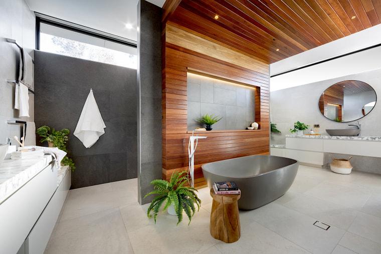The layout of this ensuite by designer Sonja architecture, bathroom, bathtub, building, ceiling, estate, floor, flooring, furniture, home, house, interior design, loft, property, real estate, room, tile, villa, gray