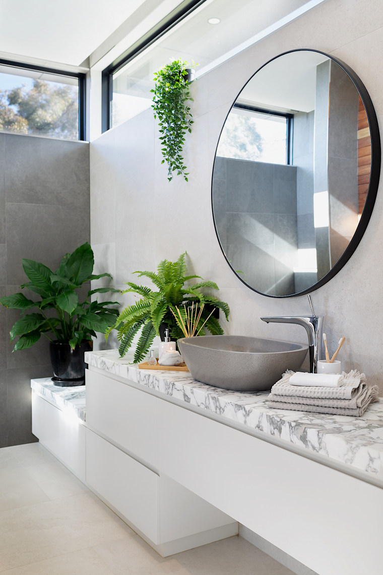 The long vanity cabinets are partially wall-mounted but architecture, bathroom, bathtub, building, ceiling, floor, flooring, furniture, glass, home, house, houseplant, interior design, living room, material property, property, real estate, room, tile, gray, white