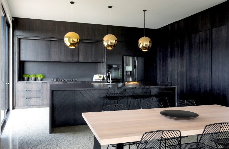 Functionality of storage and aesthetic value were the architecture, building, cabinetry, ceiling, countertop, cupboard, design, dining room, floor, flooring, furniture, home, house, interior design, kitchen, lighting, material property, property, real estate, room, table, tile, wall, black, gray