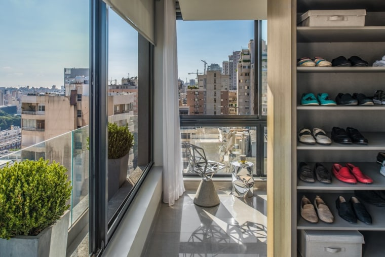 As per the client's request, a walk-in closet apartment, architecture, balcony, building, condominium, furniture, glass, home, house, interior design, mixed-use, property, real estate, room, window, gray, black