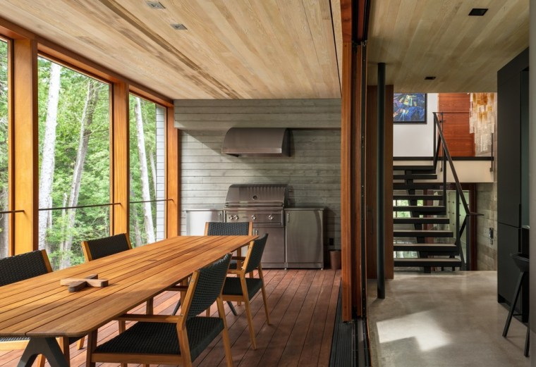 The screened-in porch is directly off the kitchen architecture, beam, building, ceiling, cottage, dining room, estate, floor, flooring, furniture, hardwood, home, house, interior design, loft, property, real estate, room, table, wood, wood flooring, wood stain, brown