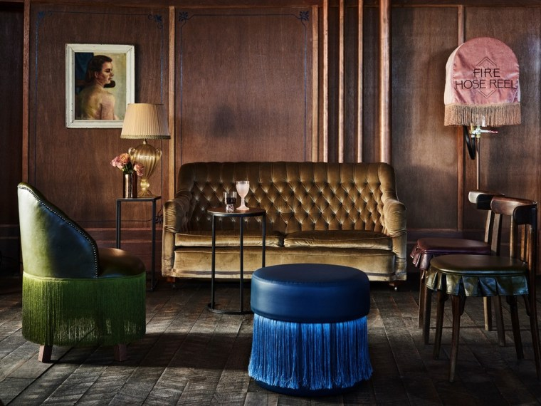 The three level Imperial Hotel Erskineville is a chair, couch, furniture, interior design, living room, room, table, black