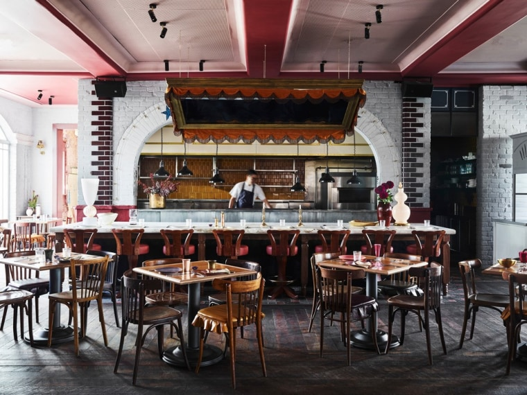 The three level Imperial Hotel Erskineville is a café, coffeehouse, interior design, restaurant, table, black