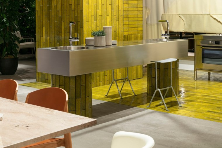 The kitchen was the starting point for their architecture, bar stool, building, chair, countertop, design, floor, flooring, furniture, house, interior design, material property, property, restaurant, room, table, yellow, brown, gray