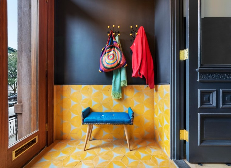 The entry vestibule is lined in orange-yellow tiles building, chair, design, floor, flooring, furniture, house, interior design, orange, red, room, table, textile, yellow, black