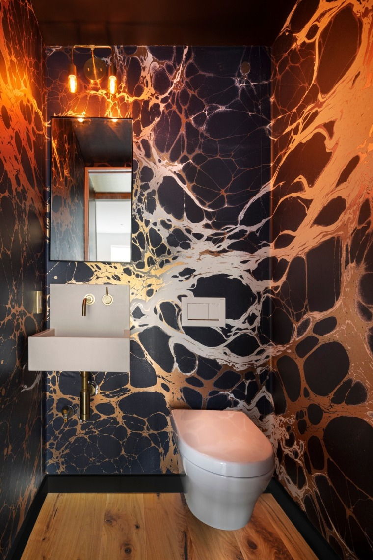 The Calico wallpaper-lined powder room is concealed from bathroom, house, interior design, plumbing fixture, room, toilet, black