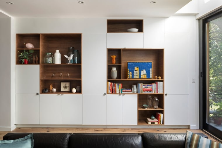 Start slow with the decluttering process – like architecture, bookcase, building, cabinetry, ceiling, couch, floor, furniture, home, house, interior design, living room, room, shelf, shelving, table, wall, wood, white