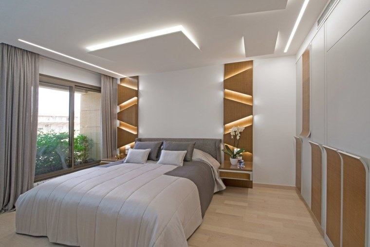 The master bedroom was also created with unique apartment, architecture, bed, bed frame, bed sheet, bedding, bedroom, building, ceiling, comfort, daylighting, floor, furniture, home, house, interior design, mattress, mattress pad, plaster, property, real estate, room, suite, wall, wood flooring, gray