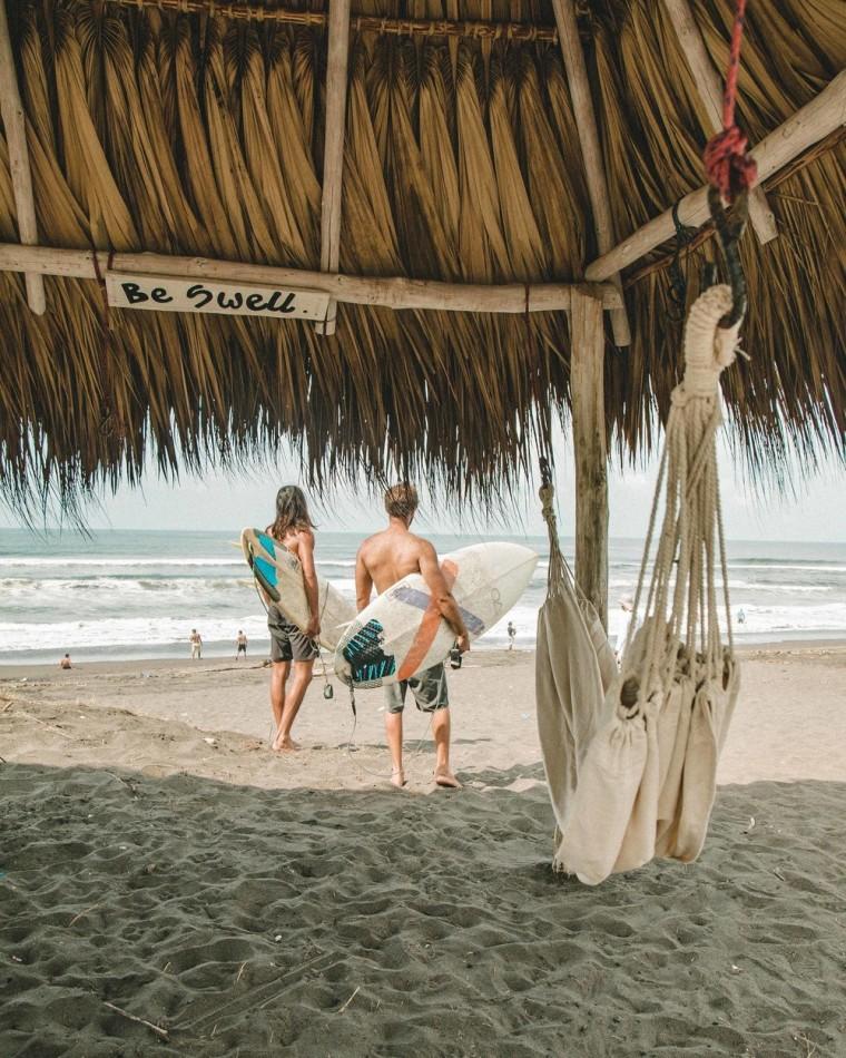 The combination of endless authentic black sand beach, beach, caribbean, fun, hammock, leisure, ocean, people on beach, sand, sea, summer, tourism, tree, tropics, vacation, brown, gray