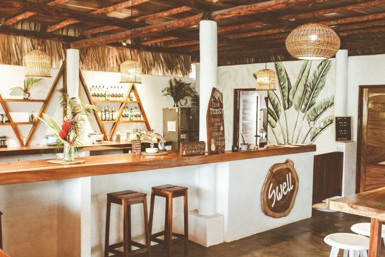 The Swell Nosh Bar nourishes the feel-good vibe beam, building, ceiling, dining room, furniture, home, house, interior design, property, real estate, room, table, brown, white