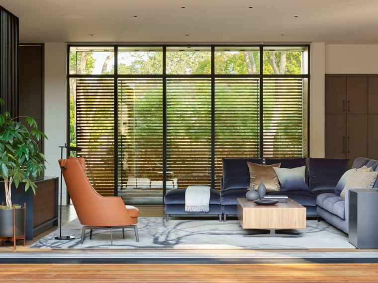 Texture, colour, and furnishings are meticulously layered piece architecture, building, ceiling, chair, couch, daylighting, door, floor, furniture, hardwood, home, house, interior design, living room, property, real estate, room, shade, window, window blind, window covering, window treatment, wood, brown