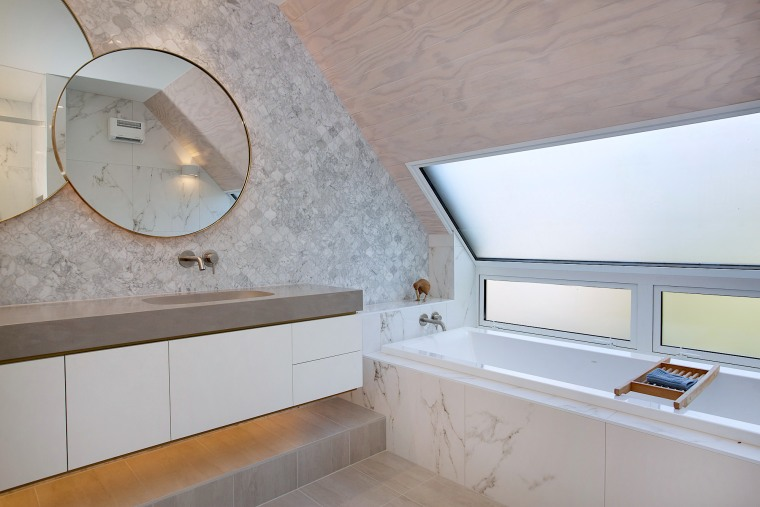 Frosted windows above the tub provide both privacy architecture, bathroom, building, ceiling, countertop, daylighting, floor, flooring, furniture, home, house, interior design, material property, plaster, property, real estate, room, tile, wall, gray