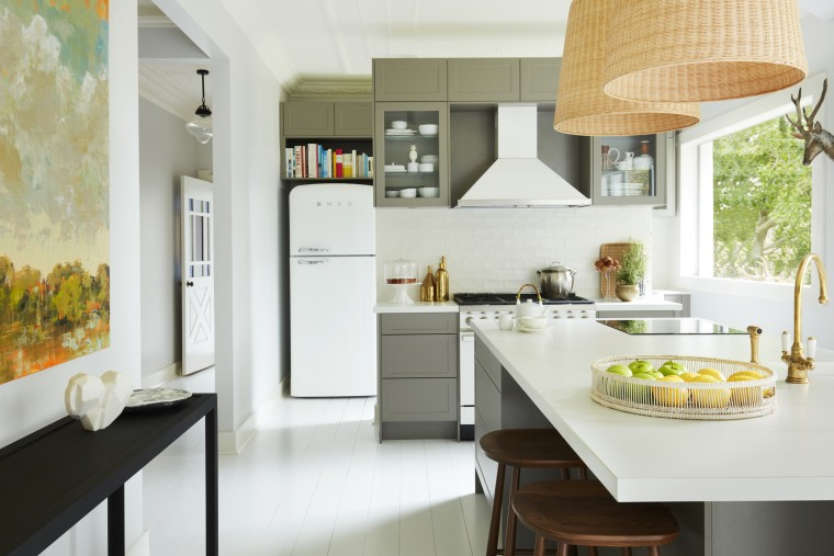 The kitchen is very much the hub of architecture, building, cabinetry, ceiling, countertop, cuisine classique, floor, flooring, furniture, home, house, interior design, kitchen, kitchen stove, material property, property, real estate, room, table, tile, yellow, white