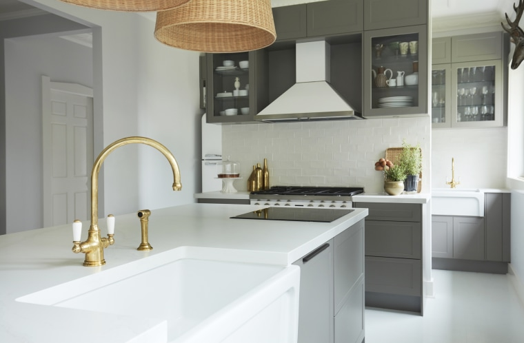 The industry was quite set on black tapware, architecture, building, cabinetry, ceiling, countertop, floor, flooring, furniture, home, house, interior design, kitchen, lighting, material property, property, real estate, room, sink, tap, tile, gray