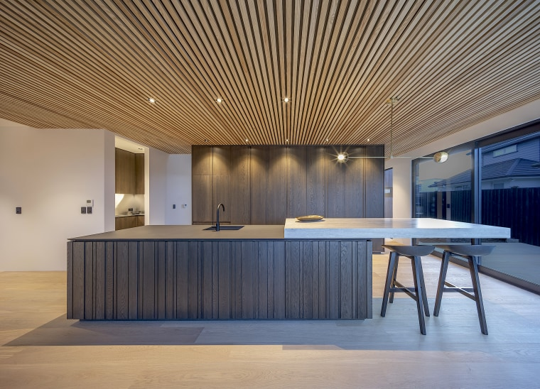 Picking up on the clean lines of the architecture, building, ceiling, design, floor, flooring, furniture, home, house, interior design, lighting, lobby, material property, property, real estate, room, table, wall, gray