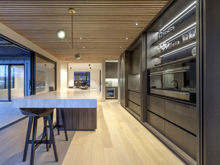 Vertical timber panelling to the island is matched architecture, building, cabinetry, ceiling, countertop, design, floor, flooring, furniture, hall, hardwood, home, house, interior design, kitchen, lighting, loft, office, plywood, property, real estate, room, table, wall, wood, wood flooring, yellow, black
