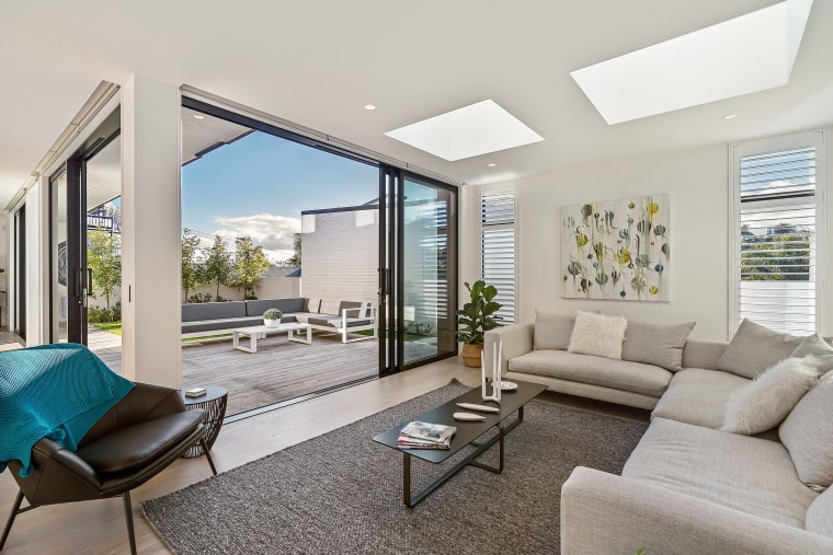 Consider incorporating skylights in various rooms of apartment, architecture, building, ceiling, coffee table, daylighting, estate, floor, furniture, home, house, interior design, living room, property, real estate, room, table, window, gray