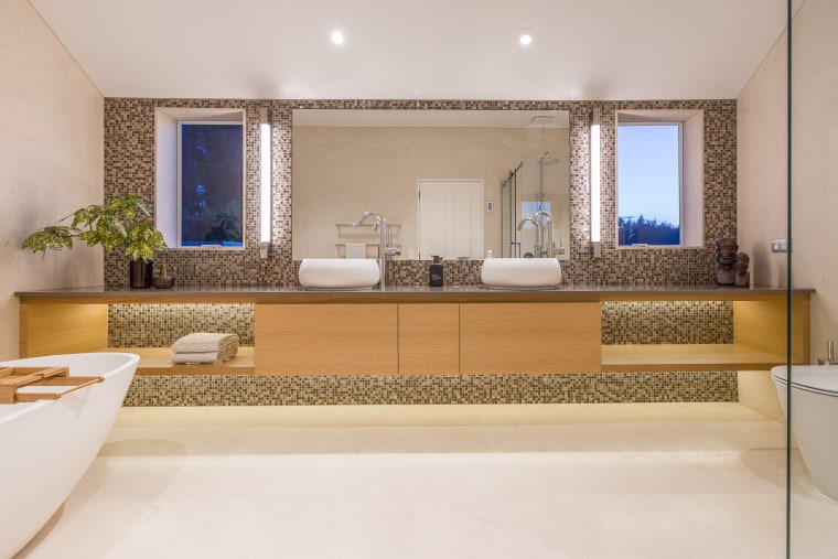 The his-and-her vanities are positioned symmetrically to the architecture, bathroom, floor, interior design, real estate, room, gray