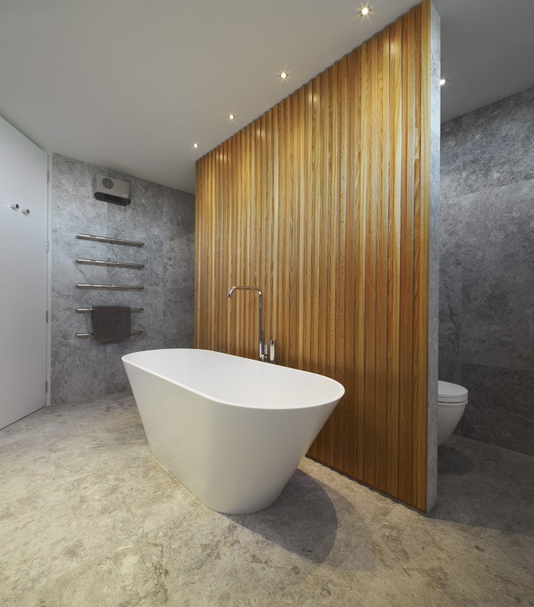 Lighter tones that blend seamlessly from the walls bathroom, floor, interior design, plumbing fixture, tile, gray