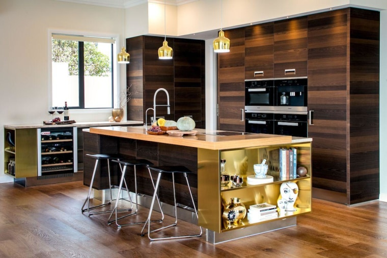 Instead of a traditional entryway, this home cabinetry, countertop, cuisine classique, furniture, interior design, kitchen, room, table, gray, black