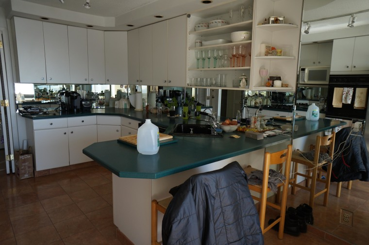 Before: The kitchen felt cluttered, dark and tired building, cabinetry, countertop, furniture, interior design, kitchen, property, real estate, room, gray, black