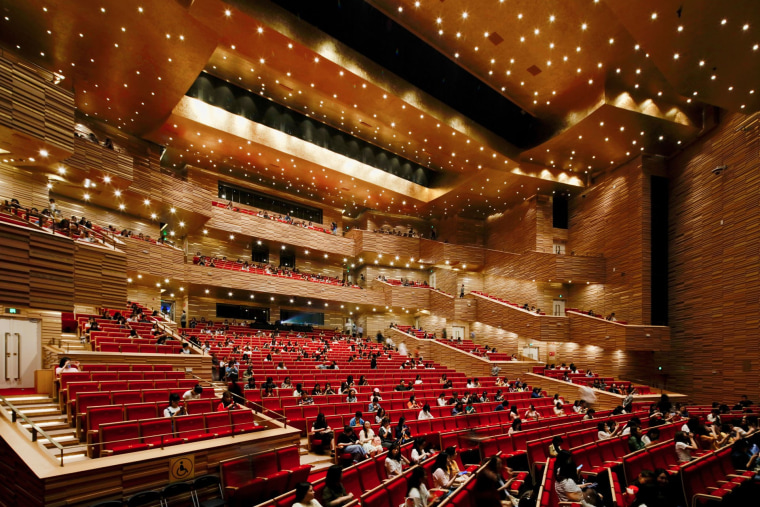 The Opera building comprises two main performance/event spaces: architecture, auditorium, building, concert hall, convention center, heater, musical instrument accessory, opera house, orchestra pit, performing arts center, stage, theatre, brown, red