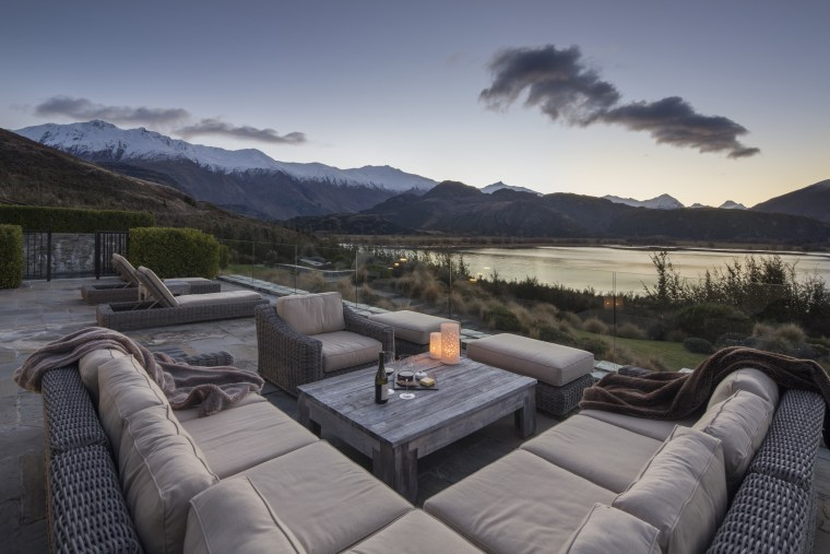 Piwakawaka Point villa, Wanaka, New Zealand - building building, estate, furniture, home, house, interior design, landscape, mountain, natural landscape, property, real estate, room, sky, tree, gray, black