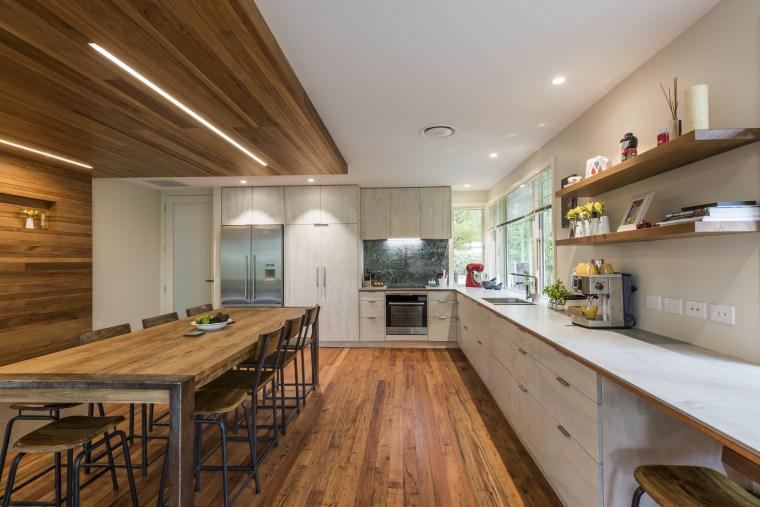 Renovation creates large open-plan living space and opens cabinetry, countertop, bencthop, Resene, floor, flooring, hardwood, interior design, kitchen, wood, wood flooring, Higham Architecture, plywood