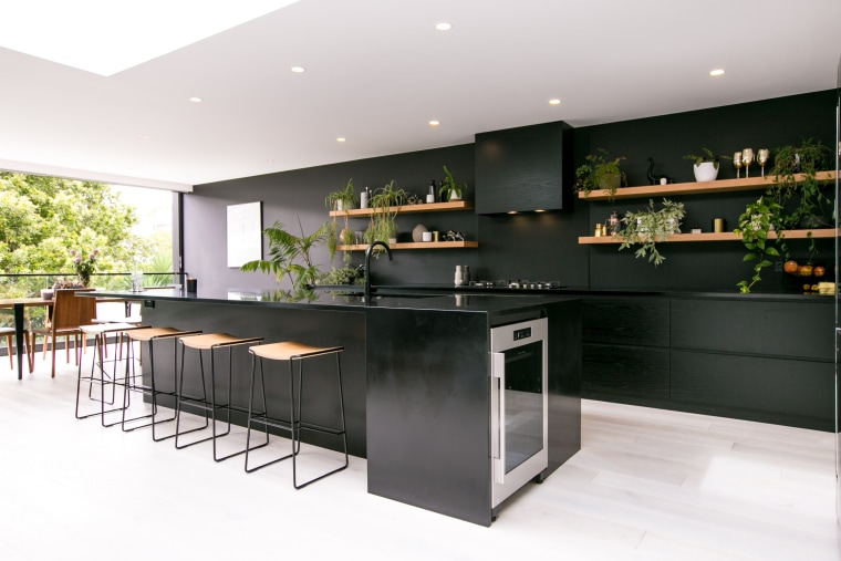 ​​​​​​​In this kitchen by architect Evelyn McNamara, Resene countertop, interior design, kitchen, white, black