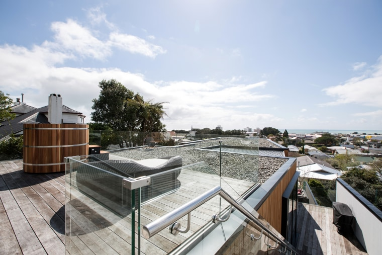 Soaking in the views – a rooftop spa home, house, outdoor structure, property, real estate, roof, water, white