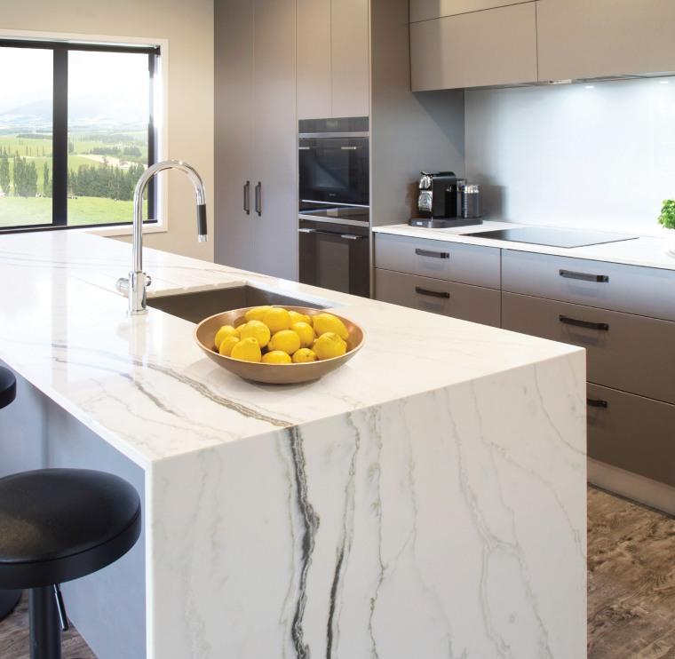 This eye-catching kitchen, also by designer Kim Primrose, countertop, floor, flooring, interior design, kitchen, table, yellow, white