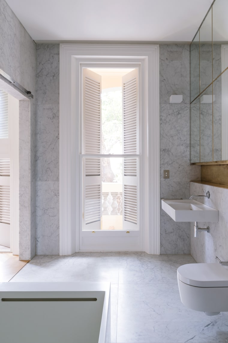 ​​​​​​​Part of a makeover of a circa 1890s architecture, bathroom, bathroom accessory, bathroom cabinet, curtain, daylighting, door, floor, home, interior design, plumbing fixture, room, sash window, tile, wall, window, window covering, window treatment, gray