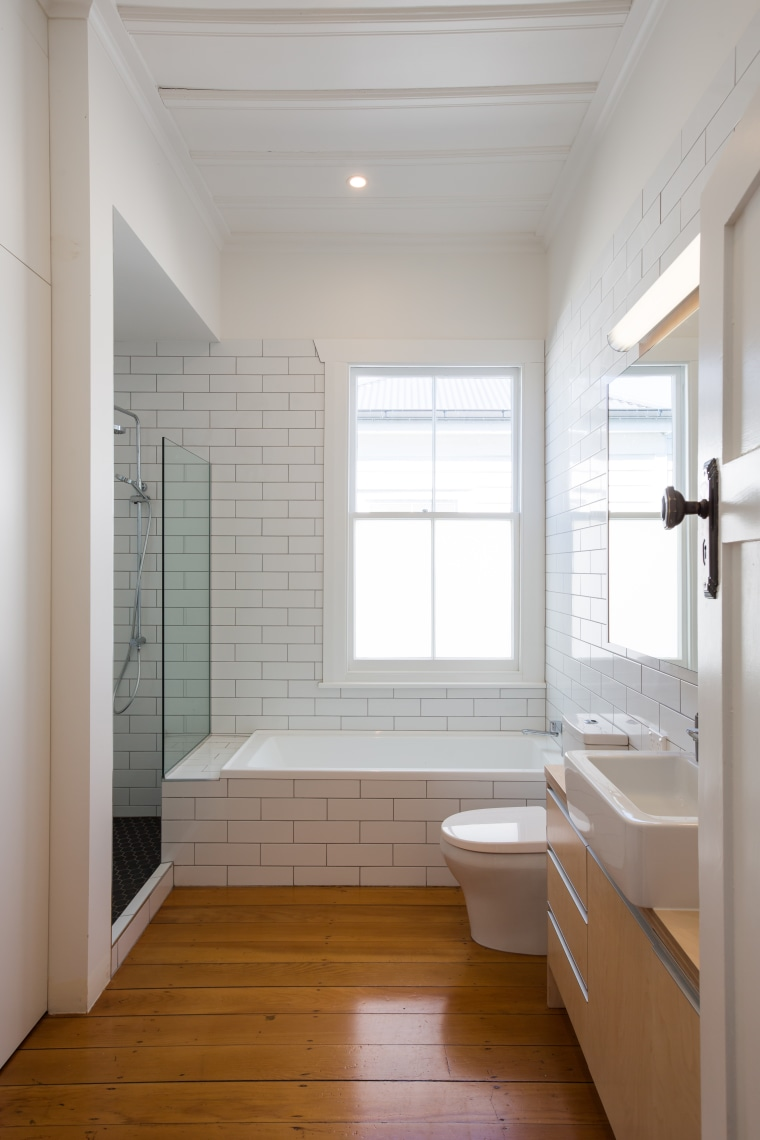 ​​​​​​​Always-current subway tiles offer elegance and low-maintenance surfaces architecture, bathroom, timber floor, plumbing fixtures, sink, basin, subway tiles, plywood, Chris Holmes, CAAHT Studio Architects