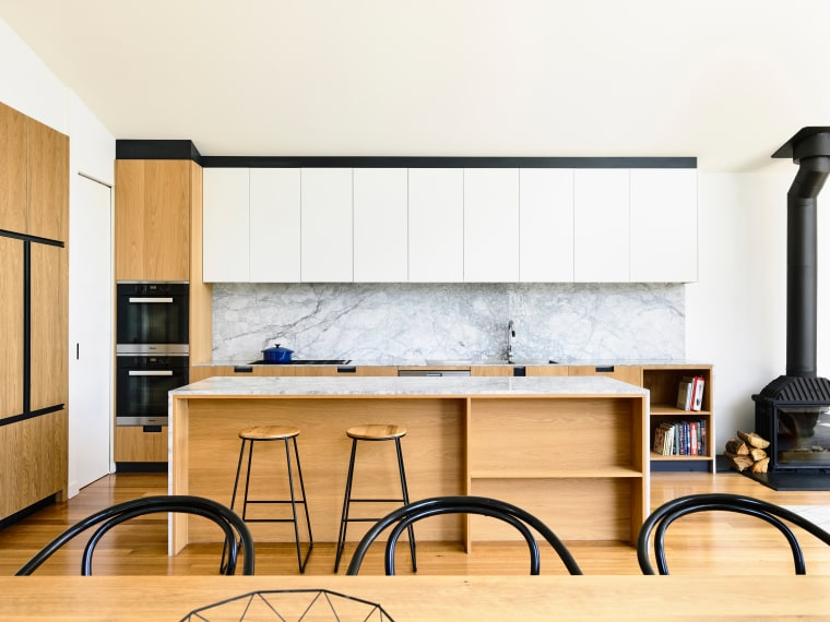 ​​​​​​​Understated design can also stand out.This minimalist entertainer's cabinetry, furniture, kitchen, wall, white, Contemporary, kitchen island, Porter Architecture