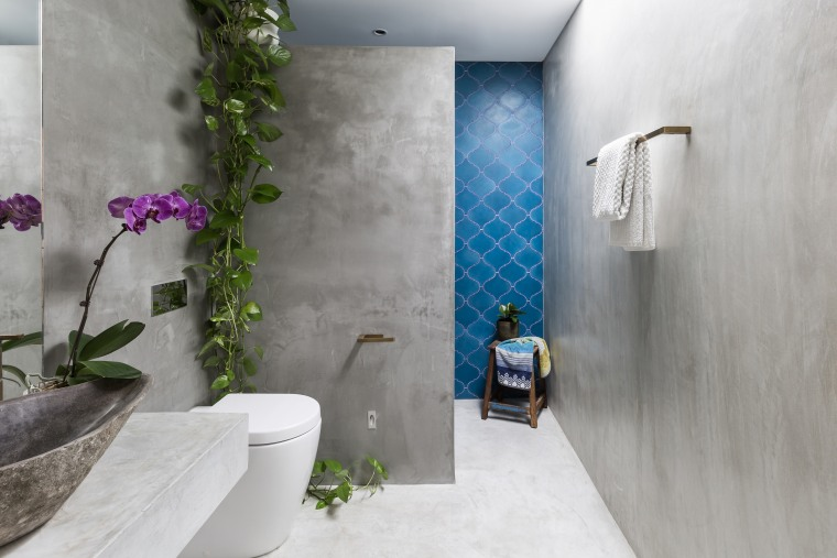 ​​​​​​​Vivid blue encaustic tiles add a splash of architecture, bathroom, interior design, gray, blue, tiles, grey, concrete vanity top