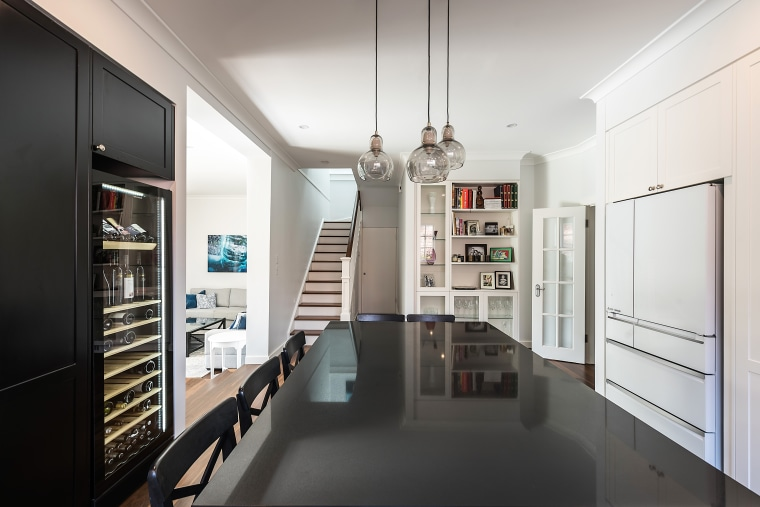 ​​​​​​​In this entertainer's kitchen, the black pantry on interior design, white, black, kitchen, kitchen design, IL Kitchens, cabinetry,