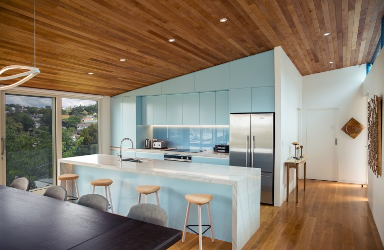 ​​​​​​​Finished in powder blue and defined by the architecture, ceiling, countertop, floor, house, interior design, table, wood, gray, brown, timber floor, Frans Kamermans