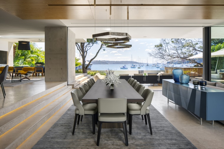 Stairs rather than walls delineate the raised kitchen architecture, dining room, interior design, dining table, furniture, timber floor,  SAOTA, travertine