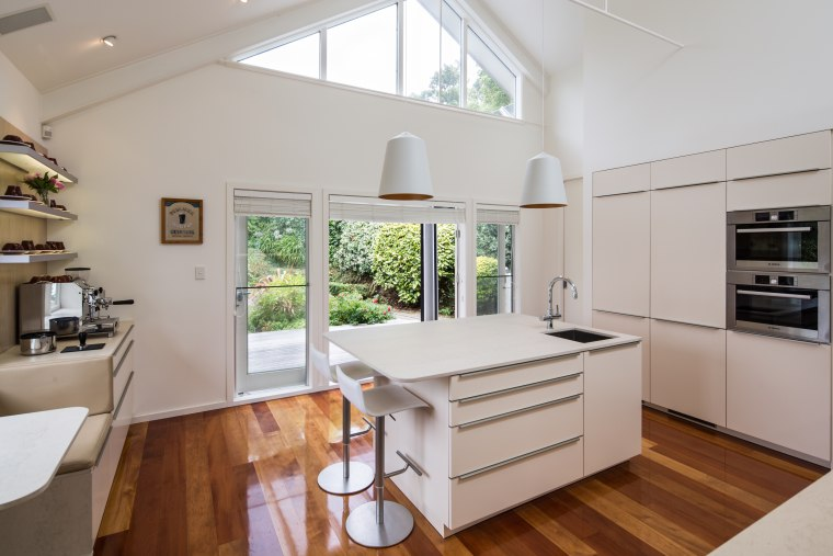 ​​​​​​​A new light-toned kitchen sits in a light-filled architecture, benchtop, interior design, kitchen, Damien Hannah, German Kitchens, white, timber floor