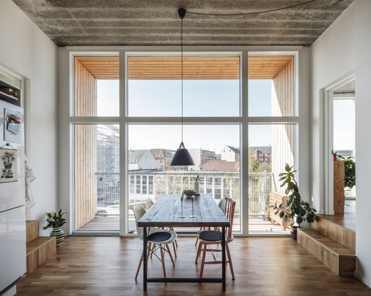 The stacking pattern of the modules used by dining room, floor, flooring, furniture, home, apartment, interior design, living room, table, Bjarke Ingels Group