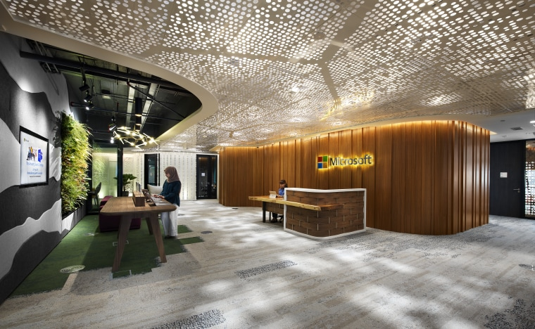 The reception desk in the new Microsoft KL architecture, ceiling, interior design, lobby, brown