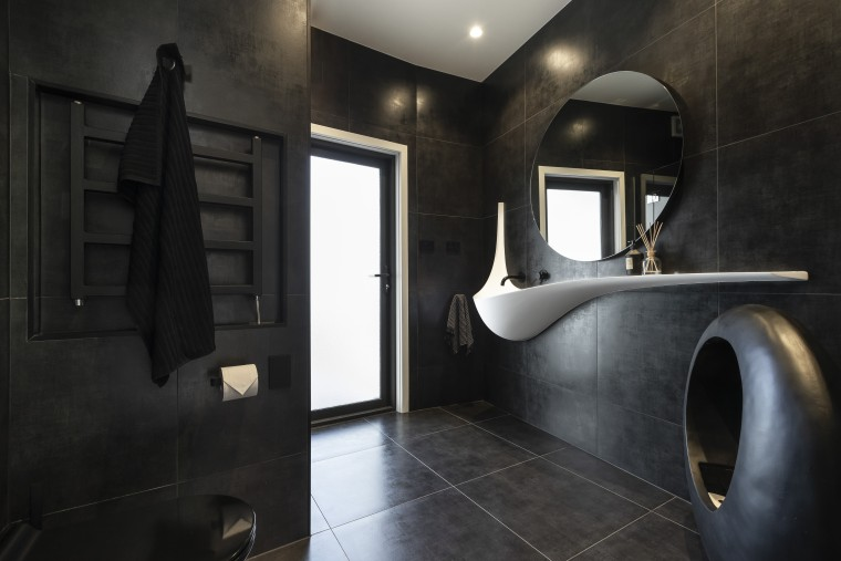 ​​​​​​​For this bathroom by designer Celia Visser, the architecture, bathroom, floor, flooring, tiles, home, house, plumbing fixtures, black, Vanity