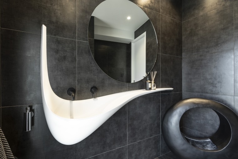 Used predominantly as a powder room and a architecture, bathroom, floor, flooring, mirror, plumbing fixture, tiles, vanity