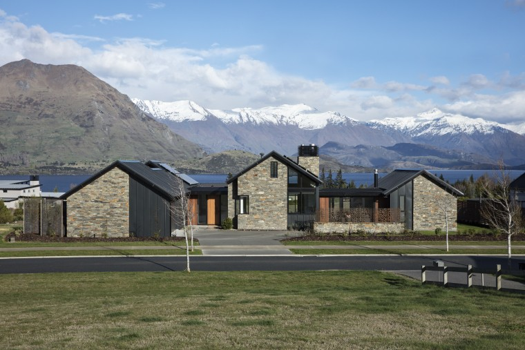 ​​​​​​​The triple peaks of this pavilion home by alps, highland, hill, home, house, andscape, roof, stone, timber, Condon Scott Architects, schist, cladding